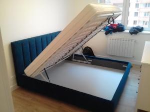 кровать с подъёмной решеткой